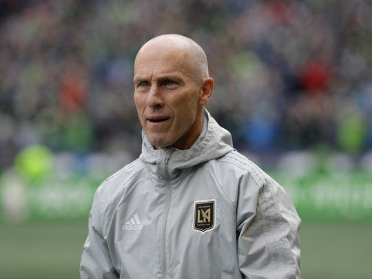 """In this March 4, 2018 photo Los Angeles head coach Bob Bradley walks on the pitch before an MLS soccer match against the Seattle Sounders in Seattle.  Probably the most prominent of the """"new"""" coaches this season is MLS vet Bob Bradley, who has the expansion Los Angeles FC in the playoff picture with seven games remaining. (AP Photo/Ted S. Warren)"""