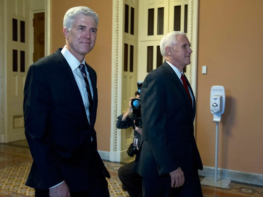 Supreme Court Justice nominee, Neil Gorsuch is joined by Vice President Mike Pence, as they walk to meet with Senate Majority Leader Mitch McConnell of Ky. on Capitol Hill in Washington, Wednesday, Feb. 1, 2017.