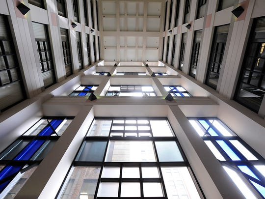 Interior view of the atrium area in the Romney Building in downtown Lansing, home to the state Department of Technology, Management & Budget and other state agencies, is seen in this 2015 LSJ file photo.