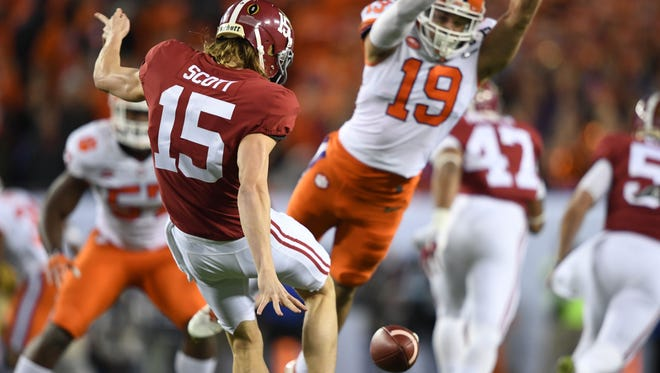 Jan 9, 2017; Tampa, FL, USA; Alabama Crimson Tide punter JK Scott (15) kicks the ball as Clemson Tigers safety Tanner Muse (19) jumps during the first quarter in the 2017 College Football Playoff National Championship Game at Raymond James Stadium. Mandatory Credit: John David Mercer-USA TODAY Sports