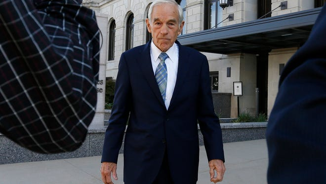 Former Republican presidential candidate Ron Paul walks out of the federal courthouse Wednesday, Oct. 14, 2015 after testifying in the trial of 2012 campaign aides Jesse Benton and Dimitri Kesari in Des Moines.