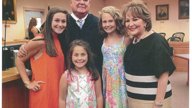 Judge Steven Kirven and his wife Sandra with their three granddaughters.