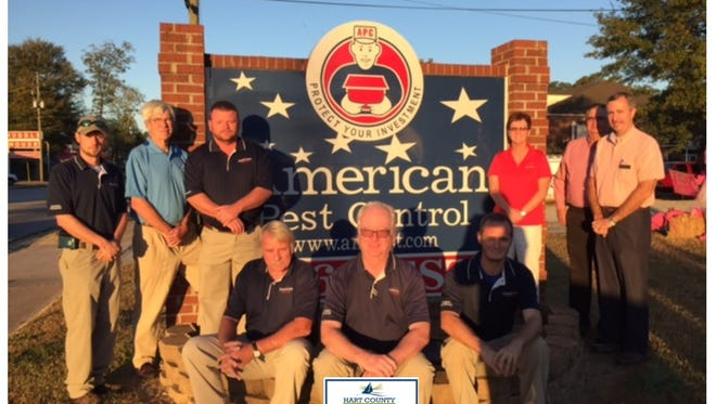 Shown from back left are Cameron Crowe, chamber board member Larry Torrence and APC manager Richard Byrum; seated are Bobby Brown, Greg Moss and David Gaines; and in the right back row are Annette Adams, chamber board member Chuck Whelan and Kevin McCraney, chamber board member. Not pictured are Rick Eitel and Wendell Perry.