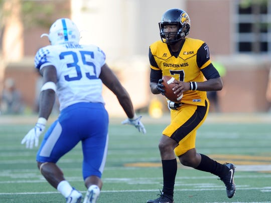 Southern Miss quarterback Kwadra Griggs runs the ball against Kentucky Saturday in the season opener for both teams.