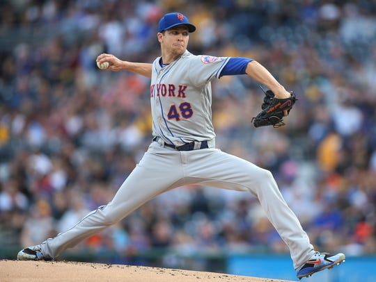 New York Mets starting pitcher Jacob deGrom (48) delivers