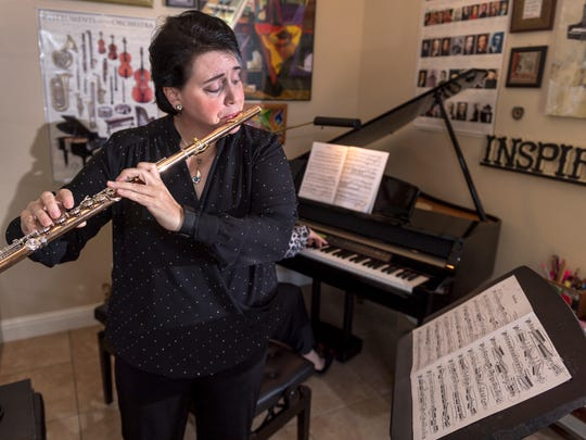 Tracy Harris of Exeter rehearses in her studio with Svetlana Harris on Wednesday, September 13, 2017. Harris is a nationally known flautist and has a new book coming out.
