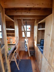 View of the desk and kitchen areas in the tiny home