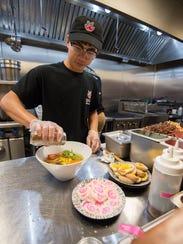 Haowen Wu prepares a vegan ramen bowl at Miyagi Ramen