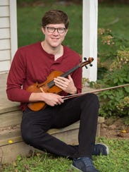 Fiddle player, Nate Grower of Dover, is a member of