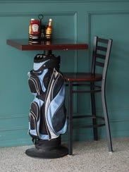 Golf bag cocktail tables can be found at Dewey Beach's newest bar: the Dewey Beach Country Club.