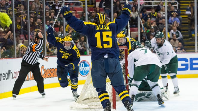 Michigan's Max Shuart and Evan Allen celebrate a goal in the first period against Michigan State on Friday, Feb. 10, 2017 at Joe Louis Arena. U-M won 5-4 in a shoot-out.