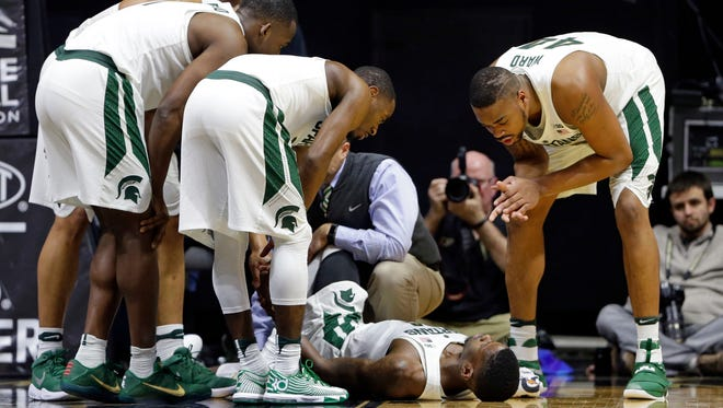 Michigan State players surround guard Eron Harris after he was injured in the second half against Purdue in West Lafayette, Ind., Saturday, Feb. 18, 2017.