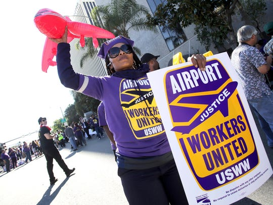 A woman joins hundreds of low-wage and minimum-wage