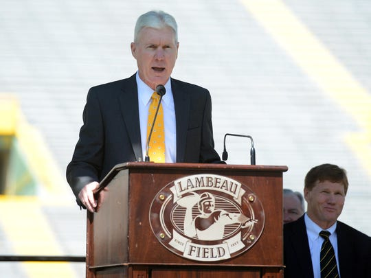 Green Bay Packers general manager Ted Thompson addresses shareholders from the stage inside Lambeau Field during the 2014 shareholders meeting.