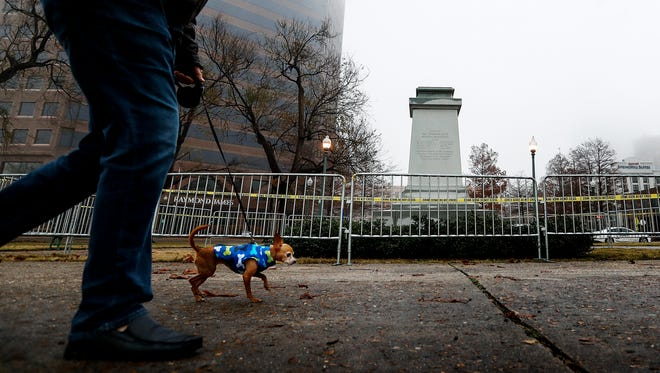 Only the pedestal remains of the removed statue of Confederate President Jefferson Davis in Fourth Bluff Park on Thursday morning. The city of Memphis sold two public parks containing Confederate monuments to a nonprofit Wednesday in a massive, months-in-the-planning operation to take the statues down overnight.