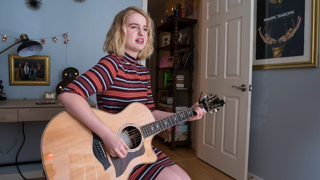 Tris Weeks, a young singer-songwriter, performs one of her songs at her home in Pensacola on Friday, June 15, 2018.  Weeks, who turns 17 on June 17th will be playing a gig at a New York City club on her birthday to celebrate.