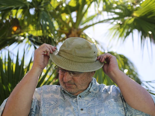 Jim Gross, of Palm Springs, puts on a hat on May 26, 2017, in Palm Springs. Gross didn't take care of his skin from the sun until he got skin cancer on his chest, nose and scalp. Now he uses sun screen and hats when outdoors.