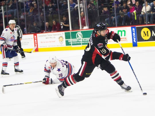 Binghamton Senators right wing Jason Akeson shoots against the Rochester Americans during the second period Saturday in Binghamton.