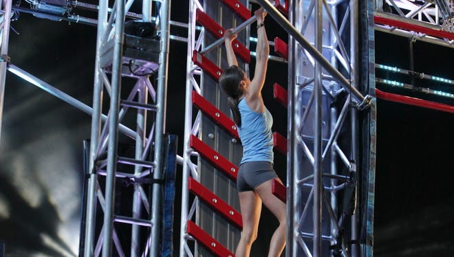 At the Dallas finals, Kacy Catanzaro pulls her way to the top, qualifying to be the next American Ninja Warrior.