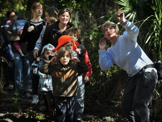 Arik Jungwirth (center), 5, of Jensen Beach, listens