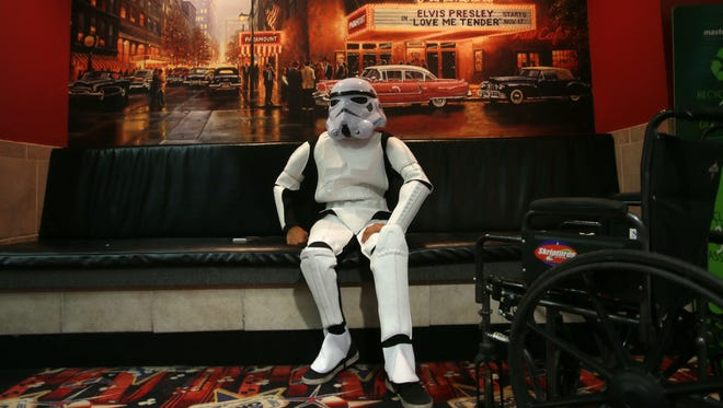 Star Wars fan Joseph Valles dressed in a storm trooper outfit as he waited in the lobby of the Bassett Place Premiere Cinemas for the first showing of the new movie Thursday.