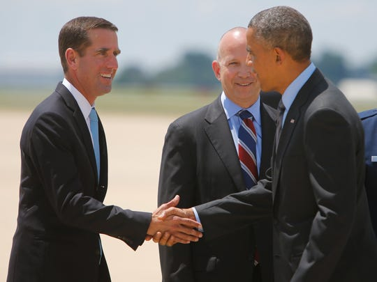 President Barack Obama shakes hands with Attorney General Beau Biden as Gov. Jack Markell stands by Thursday at the New Castle Airport.