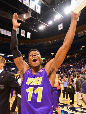 Northern Iowa Panthers guard Wes Washpun (11) celebrates after hitting the game winning shot at the buzzer to defeat the Evansville Aces in the championship game of the Missouri Valley Conference tournament at Scottrade Center.