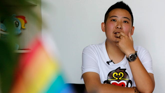 "In this May 18, 2016, file photo, a transgender equal rights supporter who goes by the name of ""Mr. C"" pauses during an interview in Beijing."