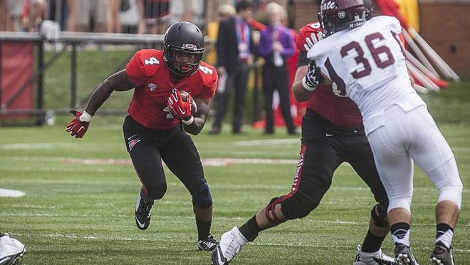 Ball State's Horactio Banks slips past Colgate's defense during their game at Scheumann Stadium Saturday afternoon.
