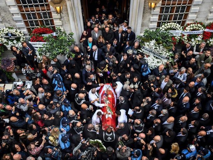 Turkish photographer Ara Guler's coffin is carried