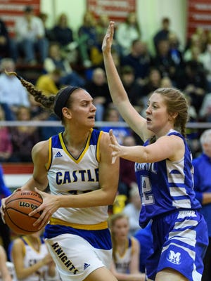 Castle's Jessica Nunge (30) looks to make a pass as she is guarded by Memorial's Mallory Housman (52) during the SIAC Tournament Championship match at Harrison High School in Evansville, Ind., Saturday, Jan. 20, 2018. The Knights defeated the Tigers, 41-32, to win their first SIAC tournament title since 2013.
