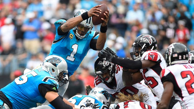 Carolina Panthers quarterback Cam Newton (1) reaches for a first down in the third quarter.