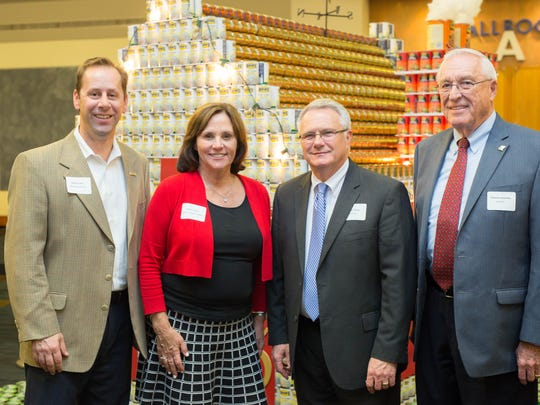 Messer Construction Co.'s Randy Fields, Second Harvest executive director Elaine Streno, and Food City's Mickey Blazer and Emerson Breeden at the Canstruction awards ceremony to benefit Second Harvest Food Bank.
