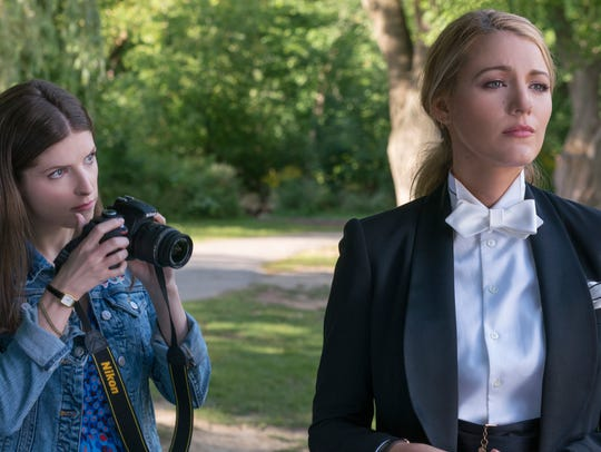 "Stephanie (Anna Kendrick, left) attempts to snap a picture of her elusive new pal Emily (Blake Lively) in ""A Simple Favor."""