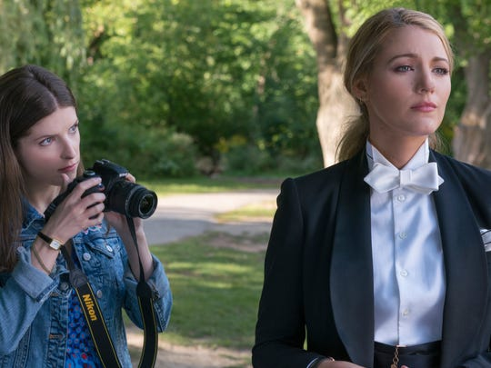 """Stephanie (Anna Kendrick, left) attempts to snap a picture of her elusive new pal Emily (Blake Lively) in """"A Simple Favor."""""""