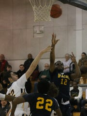 Putting up a shot Thursday is Wayne Memorial's Napier