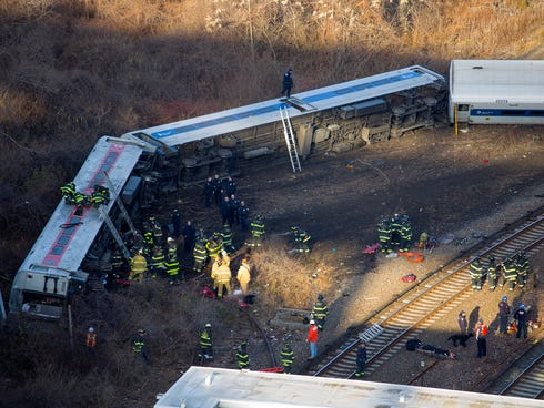 First responders gather at the derailment of a Metro North passenger train in the Bronx.