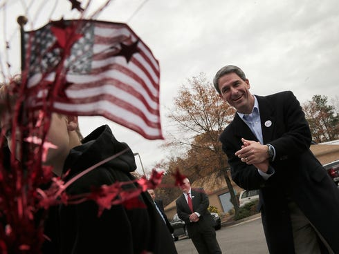Virginia gubernatorial candidate Ken Cuccinelli jokes with supporters while greeting voters at Hanover Precinct 304 at Atlee High School on Nov. 5.
