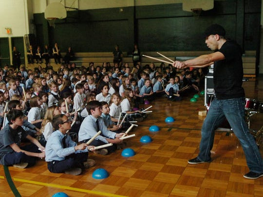 Troy Kryzalka with Number Drummer Live entertains students at Holy Name School.