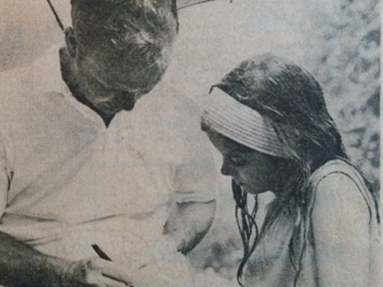 In this Democrat and Chronicle photo, Arnold Palmer is shown signing an autograph for former Brighton resident Holly Geoghegan at the 1968 U.S. Open at Oak Hill Country Club