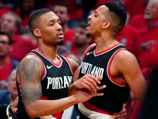FILE - In this April 21, 2018, file photo, Portland Trail Blazers guard Damian Lillard, left, restrains guard CJ McCollum during the first half of Game 4 of a first-round NBA basketball playoff series against the New Orleans Pelicans in New Orleans. It's gonna look much the same as last year for the Trail Blazers with Lillard and McCollum in the backcourt, Jusuf Nurkic at center and Al-Farouq Aminu and Maurice Harkless at forward. (AP Photo/Scott Threlkeld, File)