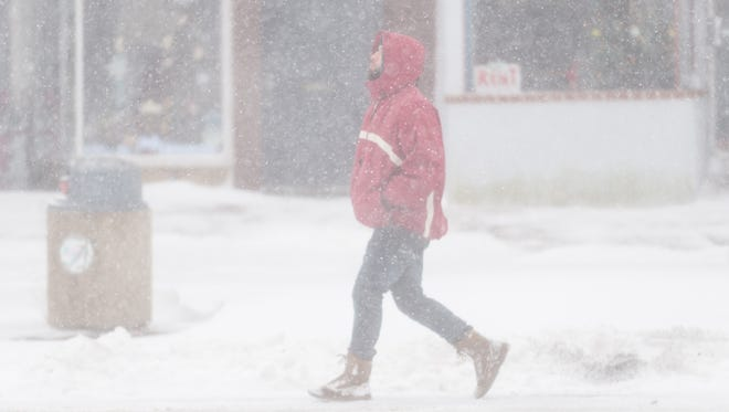 A man walks down Landis Ave to avoid unplowed sidwalks on the avenue in Vineland on Thursday, January 4.