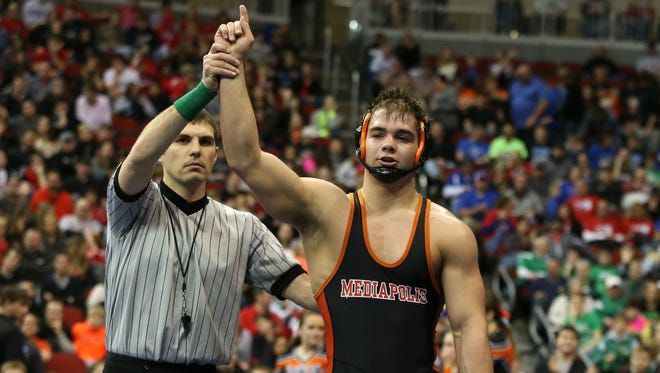 Mediapolis senior Steven Holloway beat Washington senior Brad Skubal for a title at 195 pounds in Class 2A on Saturday, Feb. 21, 2015, during the 2015 Iowa state wrestling championships at Wells Fargo Arena in Des Moines, Iowa.