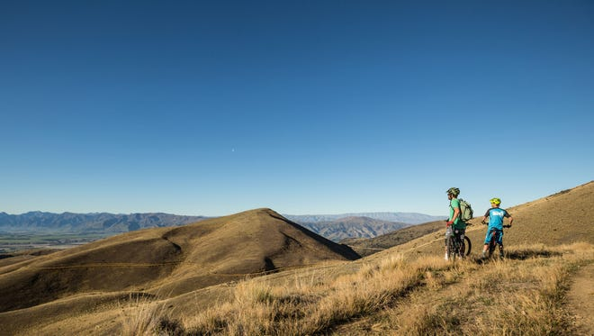 Travelers pause during a bike tour in Wanaka, New Zealand.