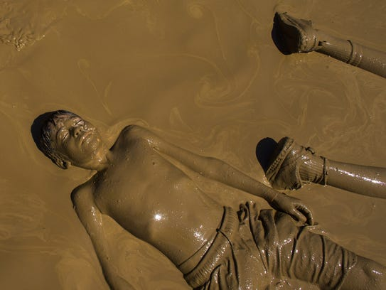 Tabin Ceja peacefully relaxes in the mud during Mighty Mud Mania Saturday in Scottsdale.