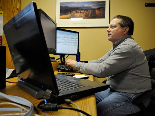 Mike Masog, network engineer, monitors the system at