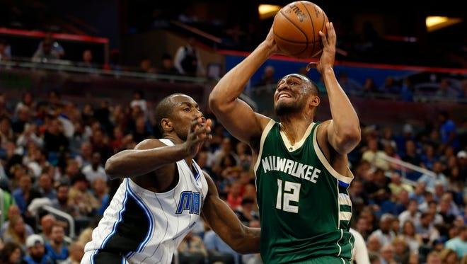 Bucks forward Jabari Parker drives to the basket as Orlando Magic forward Serge Ibaka defends.