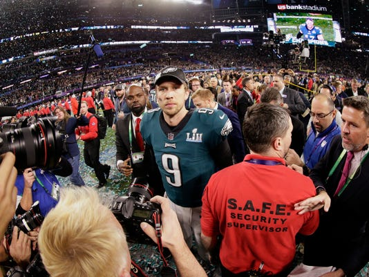 Philadelphia Eagles quarterback Nick Foles (9) walks on the field after winning the NFL Super Bowl 52 football game against the New England Patriots, Sunday, Feb. 4, 2018, in Minneapolis. The Eagles won 41-33. (AP Photo/Frank Franklin II)