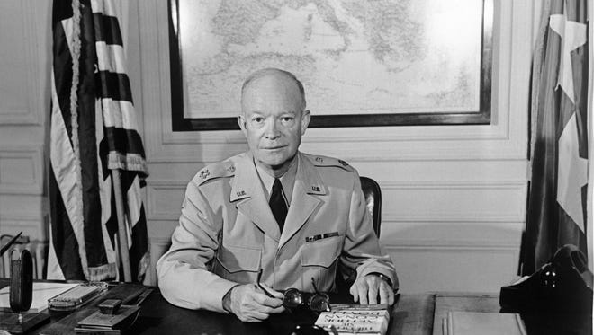"PARIS, FRANCE:  The former Commander in chief of the Allied forces in Europe (1943) and the future US President General Dwight David ""Ike"" Eisenhower (1890-1969) poses for a photographer in 1951 at NATO Paris headquarters. In 1950, Eisenhower was made supreme commander of the Combined Land Forces in NATO, and in 1952 the popularity which he had gained in Europe swept him to victory in the US presidential elections, standing as a Republican. He was re-elected in 1956. (Photo credit should read AFP/Getty Images)"