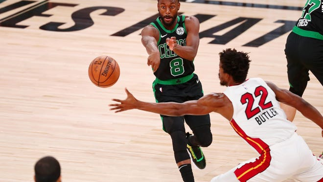 Celtics guard Kemba Walker passes the ball around Miami Heat forward Jimmy Butler  during the fourth quarter in Game 2 of the Eastern Conference Finals Thursday night in Lake Buena Vista, Fla.